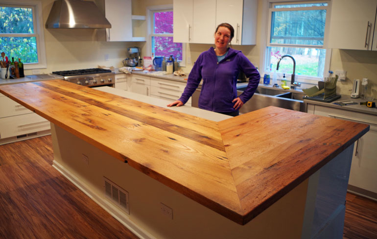 Custom Furniture Customer Standing Behind Her New Handmade L-Shaped Rustic Farmhouse Style Kitchen Countertop[Rustic Oak Barn Wood Kitchen Countertop Sold Locally]