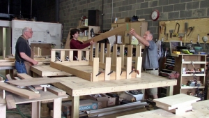 Woodworkers constructing a porch swing
