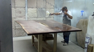 Staining a tabletop in the spray room