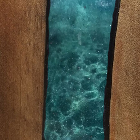 Emerald Epoxy Resin In A River Table
