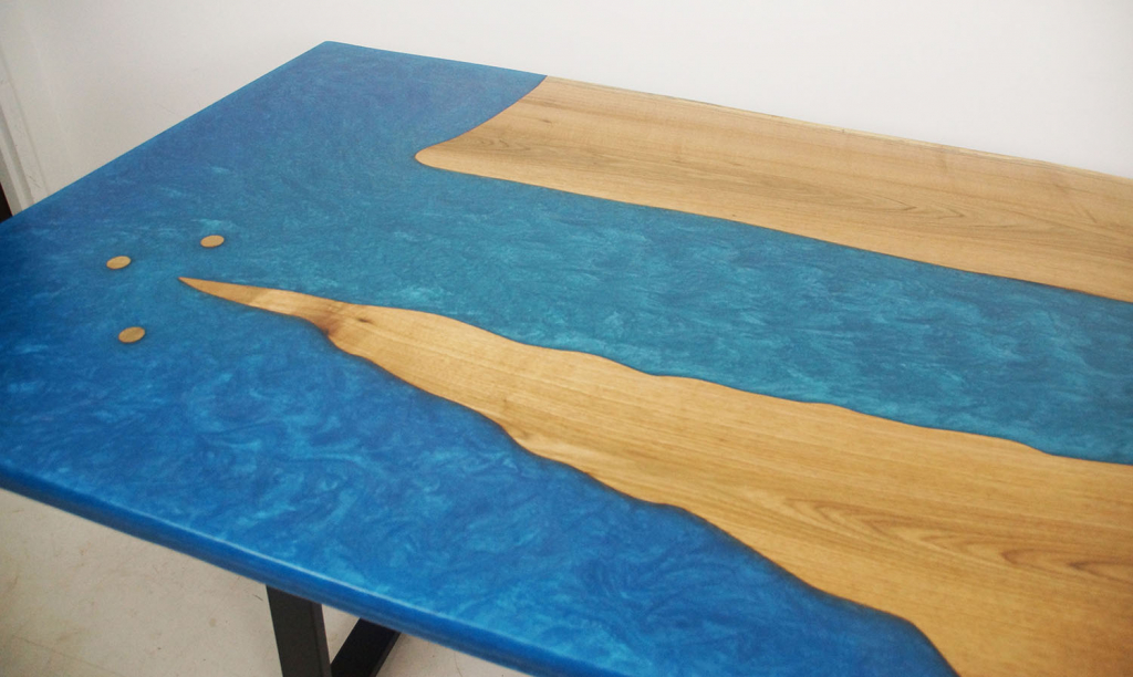 Custom Built River Table Sold Online By CVCF [Blue Epoxy Resin Water Theme Resembles A River Meeting An Ocean With Small Offshore Islands