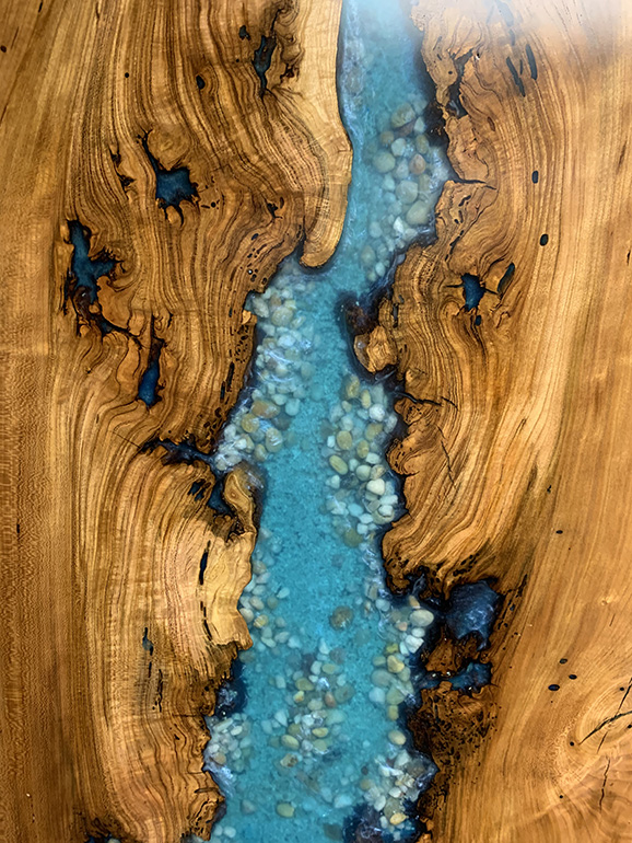Custom Made Epoxy Resin Water Themed Wall Art For Sale [Cherry Wood Epoxy River Wall Hanging With Sand And Rocks] For Sale Locally Near You (U.S. Only) And Online By Chagrin Valley Custom Furniture