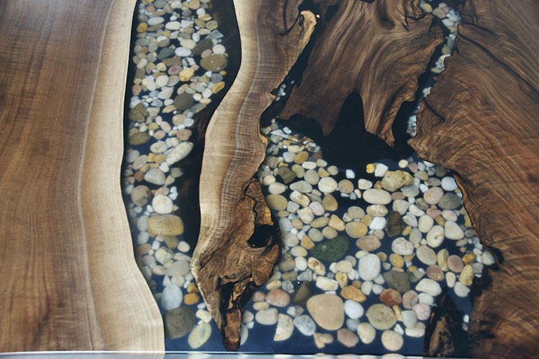Live Edge Black Walnut Dining Table With A Table Top That Features A Clear Epoxy River With Embedded River Rocks $6,500+