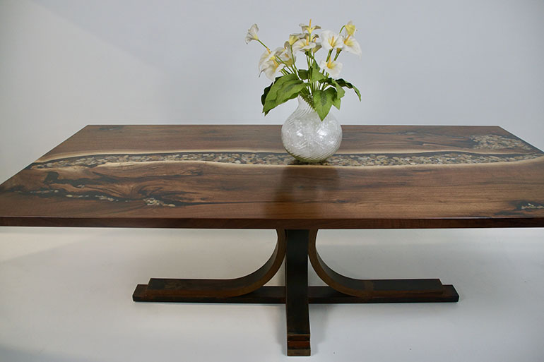 Buy A Live Edge Black Walnut Dining Table With A Table Top That Features A Clear Epoxy River With Embedded River Rocks $6,500+ [Send CVCF Your Stones] | For Sale At The CVCF River Table Online Store