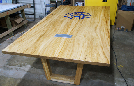 Elm Conference Table With Epoxy Resin Filled CNC Logo