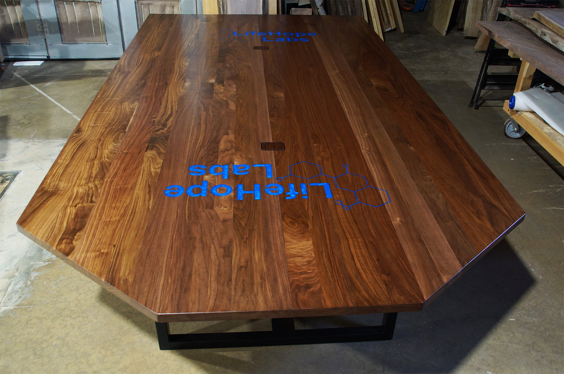 Walnut Plank Conference Table With CNC Logo